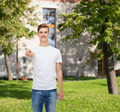 smiling young man in blank white t-shirt - PhotoDune Item for Sale