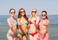 group of smiling young women on beach - PhotoDune Item for Sale