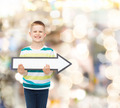 smiling little boy with blank arrow pointing right - PhotoDune Item for Sale