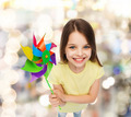smiling child with colorful windmill toy - PhotoDune Item for Sale