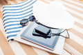 close up of tablet pc and smartphone on beach - PhotoDune Item for Sale