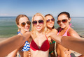 group of young smiling women making selfie - PhotoDune Item for Sale