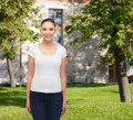 smiling young woman in blank white t-shirt - PhotoDune Item for Sale