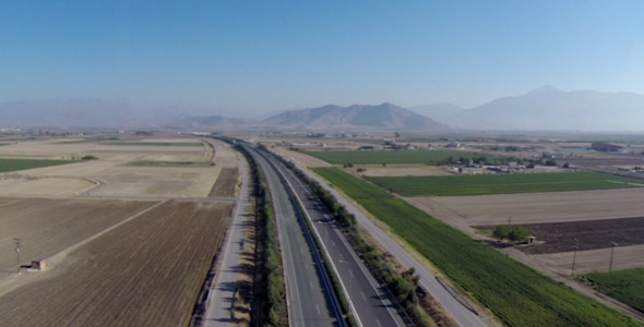 Aerial footage over highway low traffic