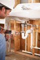 Plumber Installing Sink - PhotoDune Item for Sale
