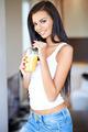 Friendly beautiful woman drinking orange juice - PhotoDune Item for Sale