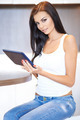 Beautiful woman relaxing at home with a tablet-pc - PhotoDune Item for Sale
