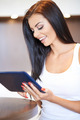 Happy young woman surfing on a tablet-pc - PhotoDune Item for Sale