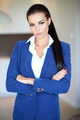 Beautiful businesswoman standing with folded arms - PhotoDune Item for Sale