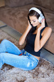 Woman relaxing on the floor listening to music - PhotoDune Item for Sale