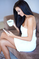 Young woman sitting texting a message - PhotoDune Item for Sale
