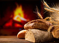 Various Bread and Sheaf of Wheat Ears on a Wooden Table - PhotoDune Item for Sale