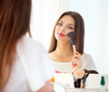 Beautiful girl looking in the mirror and applying makeup - PhotoDune Item for Sale