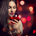 Beauty Young sexy woman drinking red wine over night background - PhotoDune Item for Sale