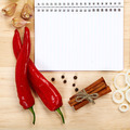 Notebook for recipes, vegetables and spices on wooden table. - PhotoDune Item for Sale