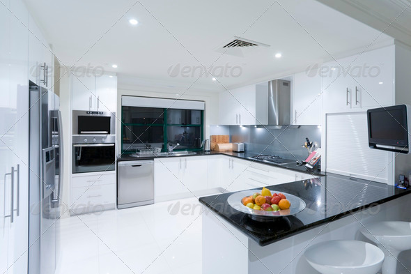 Modern kitchen in luxury mansion - Stock Photo - Images