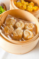 Dumplings in bamboo steamer - PhotoDune Item for Sale