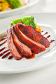 Oven crisp duck breast marinatedin a Peking duck style sauce on - PhotoDune Item for Sale