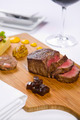 steak served on wooden tray with condiments - PhotoDune Item for Sale