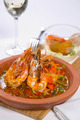 sizzling prawns with condiments and wine - PhotoDune Item for Sale