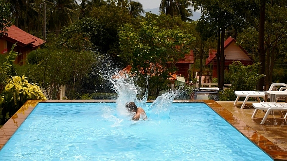 Jumping in Swimming Pool Slow Motion