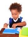 Little black boy reading books - PhotoDune Item for Sale