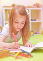 Preschooler girl painting in daycare - PhotoDune Item for Sale