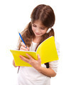 School girl writing in notebook - PhotoDune Item for Sale