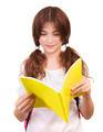 Schoolgirl reading book - PhotoDune Item for Sale