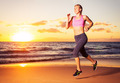 Fitness woman running at sunset - PhotoDune Item for Sale