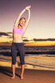 Woman stretching at sunset - PhotoDune Item for Sale