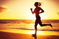 Woman running at sunset - PhotoDune Item for Sale