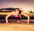 Fitness woman doing push ups - PhotoDune Item for Sale