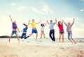 group of friends jumping on the beach - PhotoDune Item for Sale