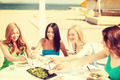 smiling girls in cafe on the beach - PhotoDune Item for Sale