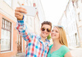 smiling couple with smartphone in city - PhotoDune Item for Sale