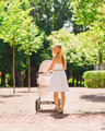 happy mother with stroller in park - PhotoDune Item for Sale