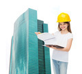 smiling little girl in hardhat with clipboard - PhotoDune Item for Sale