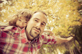 Happy father and child in autumn - PhotoDune Item for Sale