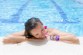 young woman resting on pool edge - PhotoDune Item for Sale