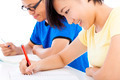 two young students studying together in classroom over white background - PhotoDune Item for Sale