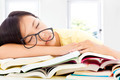 tired student girl with glasses sleeping on the books with room background - PhotoDune Item for Sale