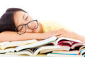 tired student girl with glasses sleeping on the books over white background - PhotoDune Item for Sale