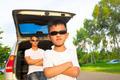 asian little boy and father with their car in the park - PhotoDune Item for Sale