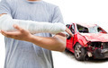 closeup of bandaged arm with blue wrecked car over white background - PhotoDune Item for Sale