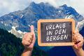 Text message - Urlaub in den Bergen on a slate - PhotoDune Item for Sale
