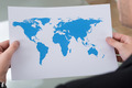 Businessman Holding World Map - PhotoDune Item for Sale