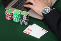 Businessman Using Laptop By Stacked Poker Chips And Cards - PhotoDune Item for Sale