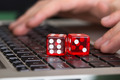 Red Game Dices On Laptop - PhotoDune Item for Sale