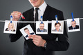 Businessman Selecting Candidate From Clothesline - PhotoDune Item for Sale